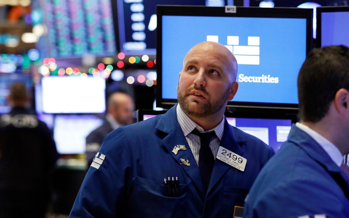 Specialist John Parisi watches the numbers near the close of trading on the floor of the New York Stock Exchange, . U.S. stocks staged a furious late-afternoon rally Thursday, closing with gains after erasing a 600-point drop in the Dow Jones Industrial AverageFinancial Markets Wall Street, New York, USA - 27 Dec 2018