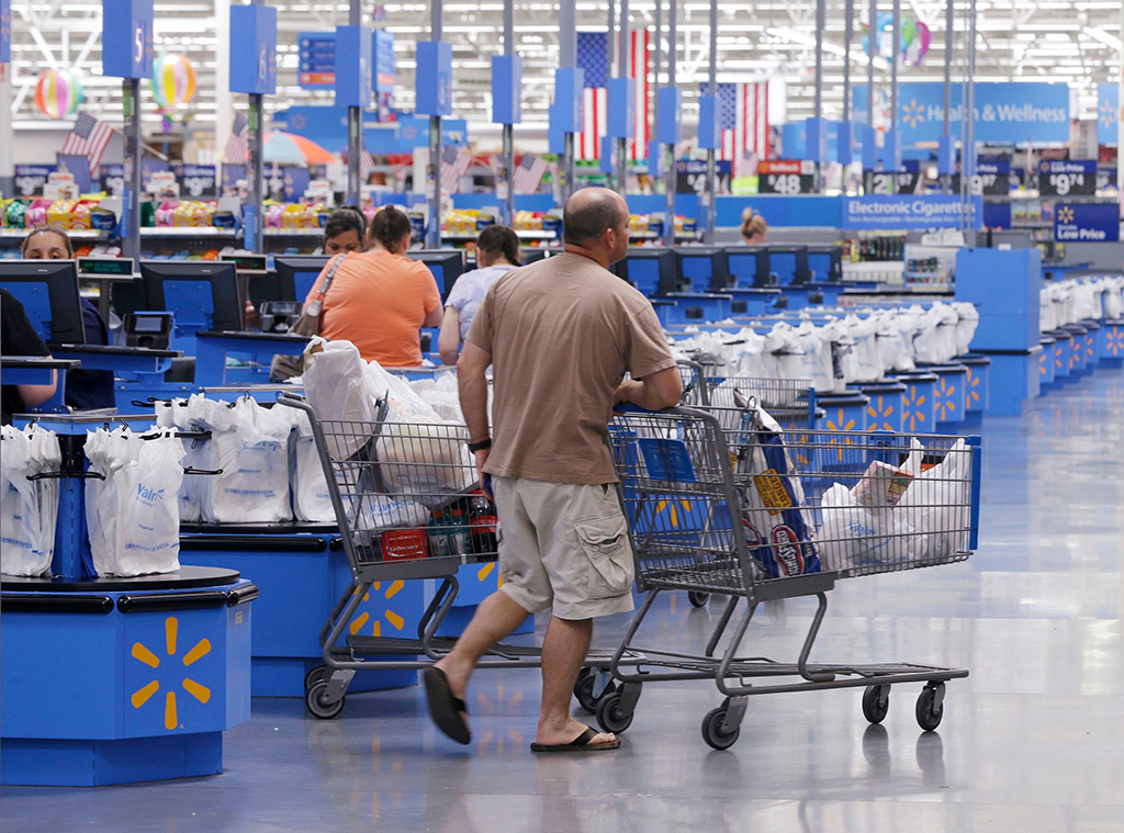 Shoppers walk from the checkout at a Wal-Mart Supercenter store in Springdale, Ark. Wal-Mart announced Friday, Jan. 15, 2016, that it is closing 269 stores, more than half of them in the U.S. and another big chunk in its challenging Brazilian market. The store closures will start at the end of JanuaryWal-Mart-Store Closures, Springdale, USA