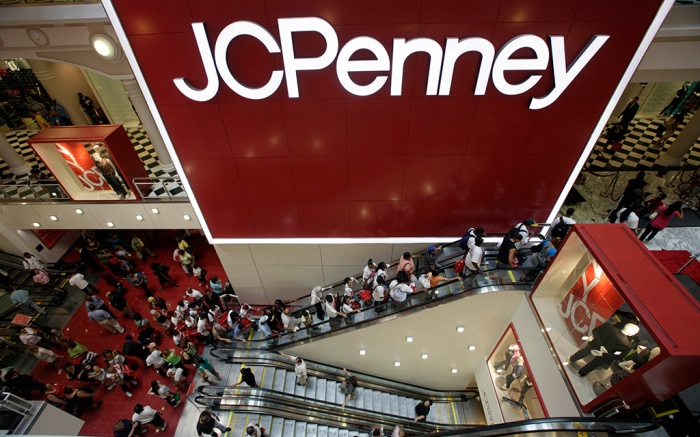Customers are seen in the main entrance of the new JCPenney store in the Manhattan Mall during the grand opening in New York. Tight inventory controls and exclusive store label brands pushed J.C. Penney Co. into profitability in the second quarter, . But the department store offered cut its profit outlook because of the uncertain economyEarns Penney, New York, USA