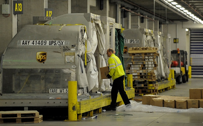 A worker places parcels at the UPS distribution center at the International Cargo Airport in Cologne, western Germany, . After intercepting two mail bombs addressed to Chicago-area synagogues, investigators found out that packages that terrorists in Yemen attempted to smuggle onto an aircraft in a brazen al-Qaida terror plot were moved through CologneGermany Airport Security, Cologne, Germany
