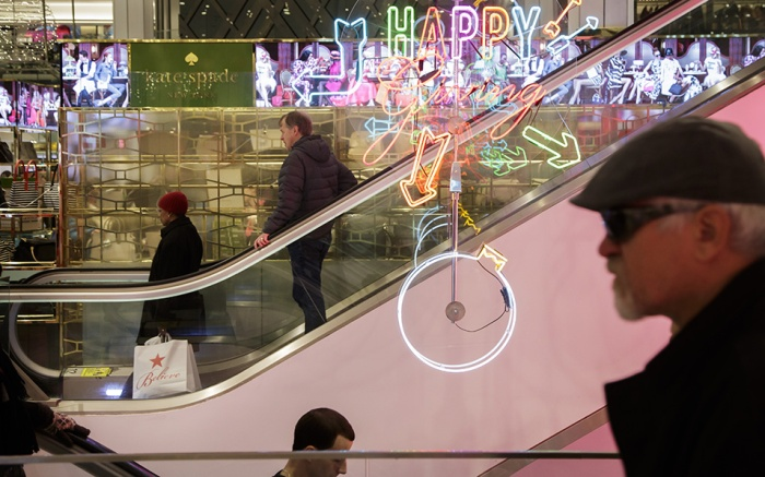 People shop in a Macy's department store in New York, New York, USA, on 22 December 2016. The United States Commerce Department released a monthly report on 22 December indicating that consumer spending increased modestly in November.US Consumer Spending, United States - 22 Dec 2016