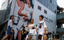 Shoppers walk through the capital city's