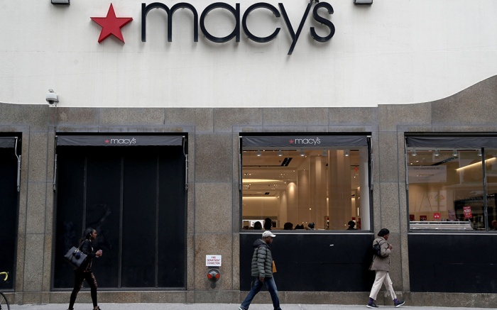 People walk in front of a Macy's Store in Brooklyn, New York, USA, 11 May 2017. Macy's stock dropped more than 17 percent following an earnings report that did not meet expectations.Macy's stock drops following earnings report, Brooklyn, USA - 11 May 2017