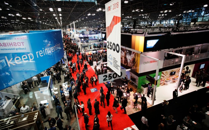 Guests at the National Retail Federation convention walk through the Jacob Javits Convention Center, in New YorkRetail Convention, New York, USA - 14 Jan 2018
