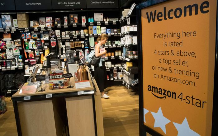 A shopper browses items on display at the Amazon 4-star store in New York.