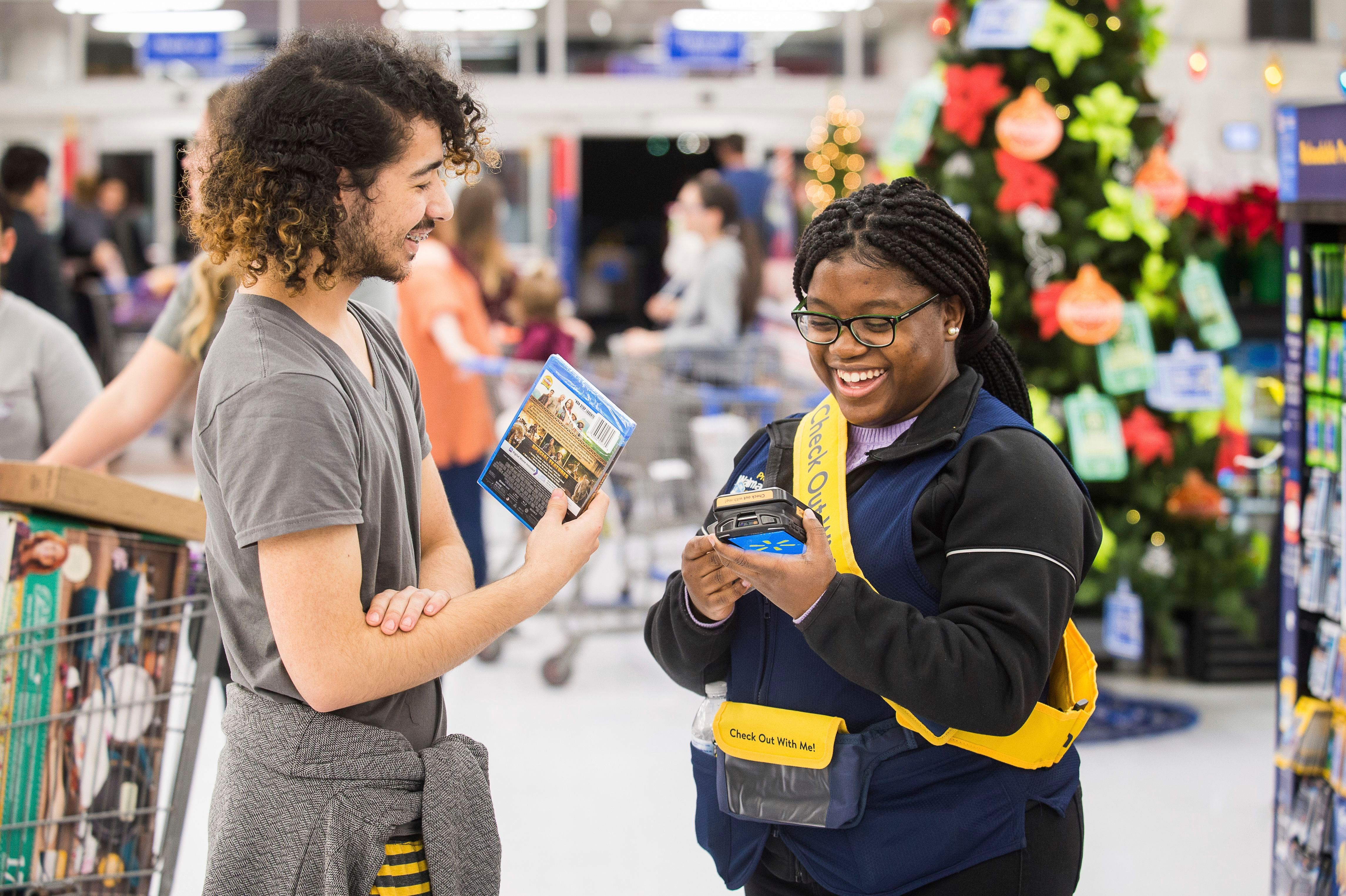 Walmart customer makes a purchase with a Check Out With Me Associate on in Bentonville, ArkWalmart Black Friday In-Store Event, Bentonville, USA - 22 Nov 2018