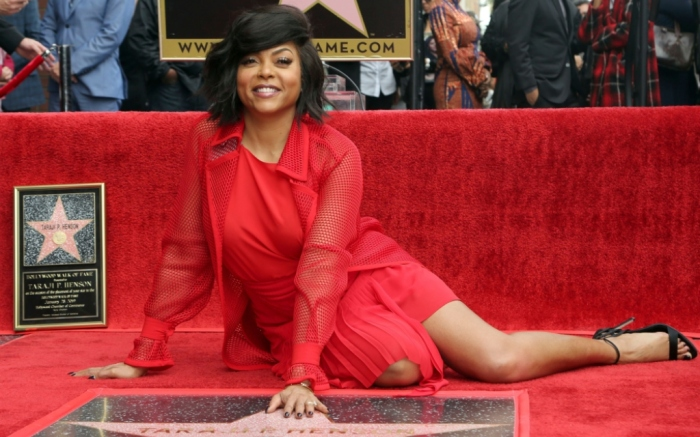 Taraji P. Henson posing with her star on the Hollywood Walk of Fame