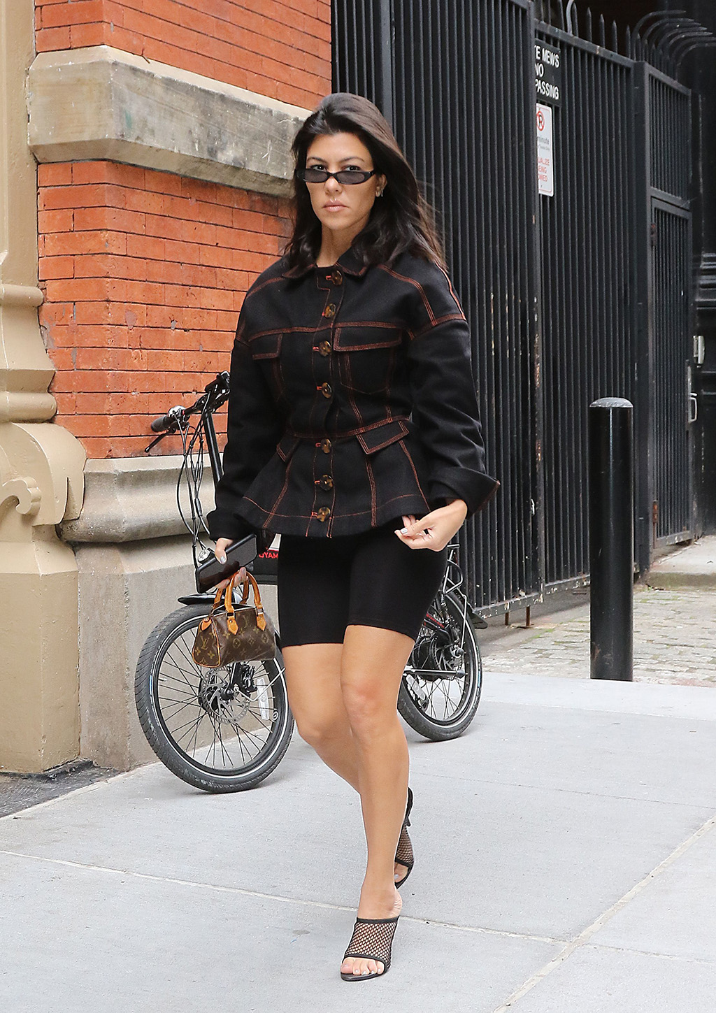Kourtney KardashianKendall Jenner and Kourtney Kardashian out and about, New York, USA - 05 Jun 2018 WEARING YEEZY JACKET AND NAKED WARDROBE SHORTS SHOES BY YEEZY BAG BY LOUIS VUITTON