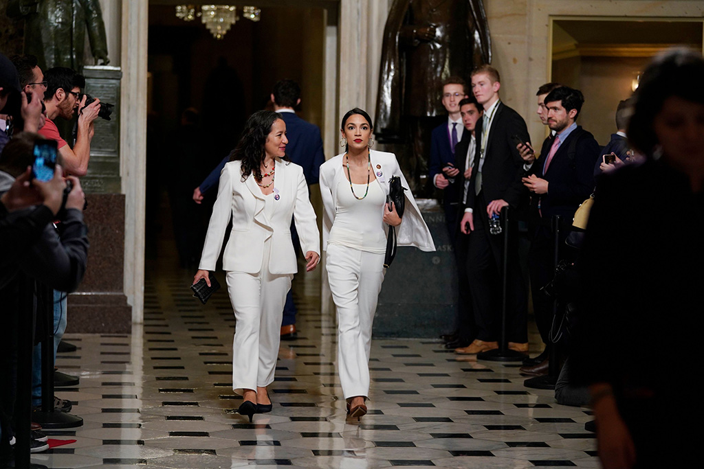 Rep. Alexandria Ocasio-Cortez, D-N.Y., right arrives with her guest, Ana Maria Archila of New York, N.Y., to hear President Donald Trump deliver his State of the Union address to a joint session of Congress on Capitol Hill in WashingtonState of Union, Washington, USA - 05 Feb 2019