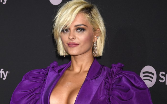 Bebe Rexha, purple plunging minidress, legs, black mid-calf boots, celebrity style, spotify new artists pre-grammy party