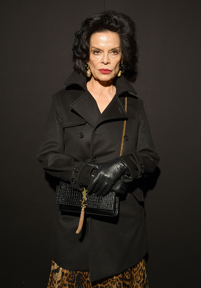 Bianca Jagger, black coat, leopard print dress, fall 2019, in the front rowSaint Laurent show, Fall Winter 2019, Paris Fashion Week, France - 26 Feb 2019