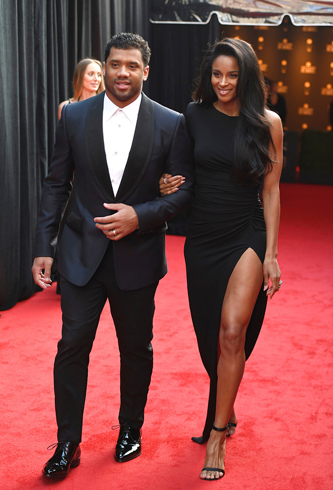Russell Wilson, Ciara, legs, red carpet, celebrity style, alexandre vauthier, legs,. Russell Wilson of the Seattle Seahawks, left, and Ciara arrive at the 8th Annual NFL Honors at The Fox Theatre, in Atlanta8th Annual NFL Honors, Atlanta, USA - 02 Feb 2019