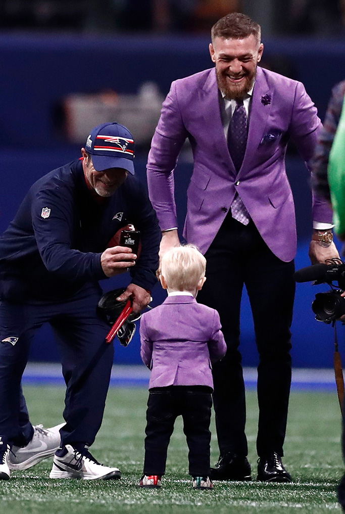 UFC fighter Conor McGregor (R) and son, Conor McGregor Jr., (C) on the field prior to the start of Super Bowl LIII between the New England Patriots and the Los Angeles Rams at Mercedes-Benz Stadium in Atlanta, Georgia, USA, 03 February 2019.Super Bowl LIII, Atlanta, USA - 03 Feb 2019