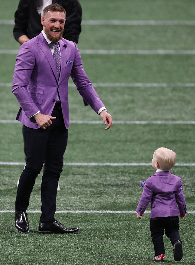 Conor McGregor with his son Conor Jack McGregor Jr. on the field before the Super Bowl LIIILos Angeles Rams v New England Patriots, Super Bowl, Mercedes Benz Stadium, Atlanta, Georgia, USA, 03 Feb 2019
