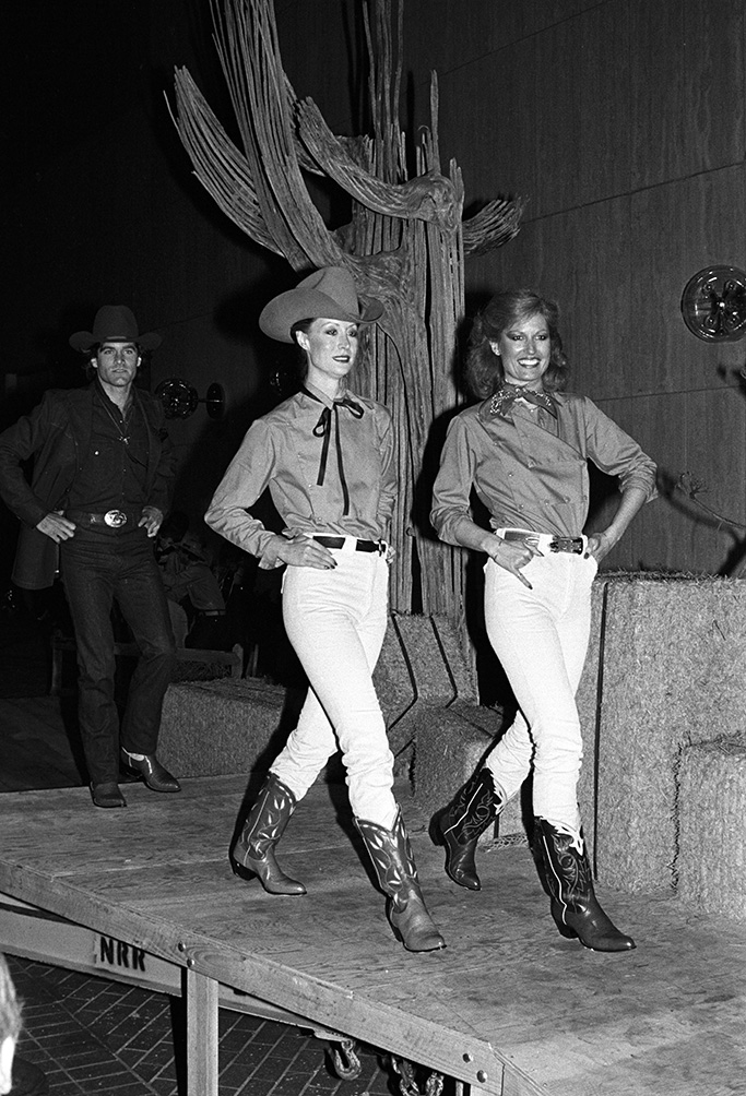 """Models on the runway during the Western gala highlighting Ralph Lauren's western wear and jeans in a foot stompin', hand-clappin' fashion show benefiting the Motion Picture Television fund put on Neiman-Marcus on May 7, 1979 in Beverly Hills, California...Article title: """"S-hoedown"""""""