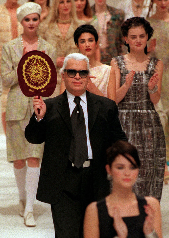 LAGERFELD Chanel fashion house designer Karl Lagerfeld acknowledges applause after he presented the 1998 Spring Summer ready-to-wear collection in ParisFRANCE FASHION CHANEL, PARIS, France