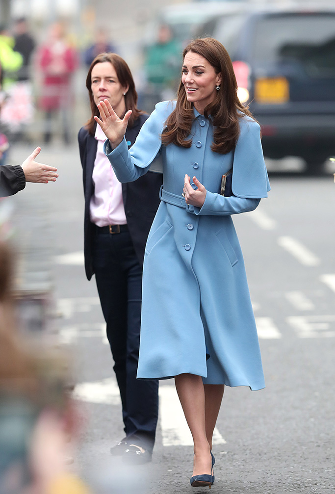 Kate Middleton, celebrity style, cape coat, baby blue, navy heels, rupert sanderson, jimmy choo clutch, Catherine Duchess of Cambridge visits the charity Cinemagic at the Braid Centre, BallymenaPrince William and Catherine Duchess of Cambridge visit to Northern Ireland - 28 Feb 2019The Duke & Duchess of Cambridge visit the Braid Centre, Ballymena, Northern Ireland. As well as meeting members of the public, Their Royal Highnesses visited the charity Cinemagic to see how they use film, television and digital technologies as a means to educate, motivate and inspire young people. Wearing Mulberry