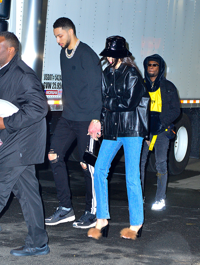 Kendall Jenner, Milin, fluffy sandals, leather jacket, mom jeans, bucket hat, boyfriend, and Ben Simmons holding hands leaving MSG after a win against The Knicks.Pictured: Kendall Jenner and Ben Simmons, 76ers, pda, nike