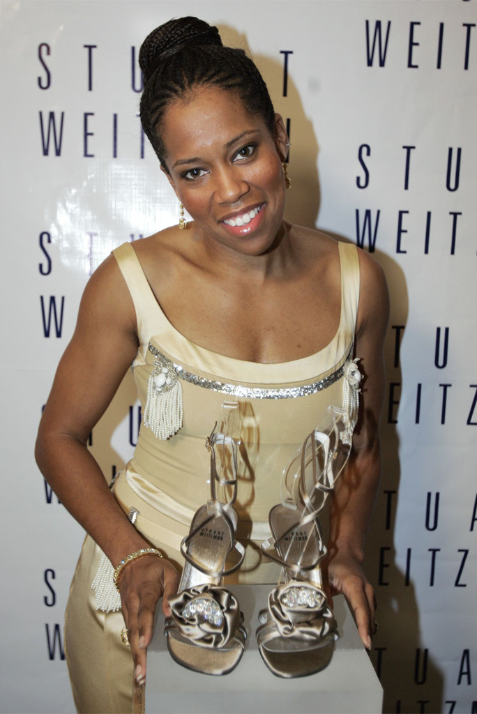 """KING Regina King, co-star of the Oscar-nominated film """"Ray,"""" poses with a pair of shoes designed and unveiled by shoe designer Stuart Weitzman before Weitzman's annual pre-Oscar party Thursday night, at Christie's Auction House in Beverly Hills, Calif. The shoes, which King will wear on the red carpet before Sunday Oscar's telecast, were designed using two earrings once owned by the late actress Marilyn MonroeWEITZMAN OSCAR PRE PARTY, BEVERLY HILLS, USA"""