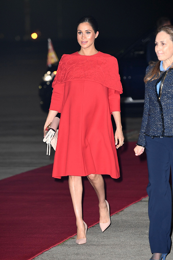 Meghan Markle, valentino, red dress, casablanca, celebrity style, dior, pumps, Duchess of Sussex arrives at Casablanca airportPrince Harry and Meghan Duchess of Sussex visit to Morocco - 23 Feb 2019