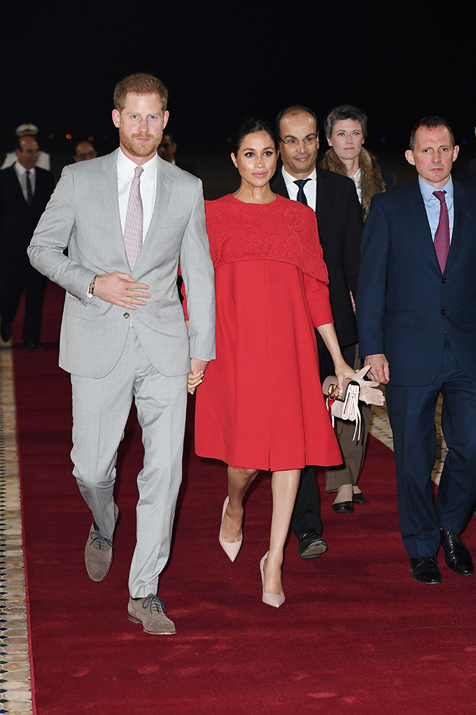 meghan markle, valentino, red dress, celebrity style, dior, heels, pumps, Prince Harry and Meghan Duchess of Sussex arrive at Casablanca airportPrince Harry and Meghan Duchess of Sussex visit to Morocco - 23 Feb 2019