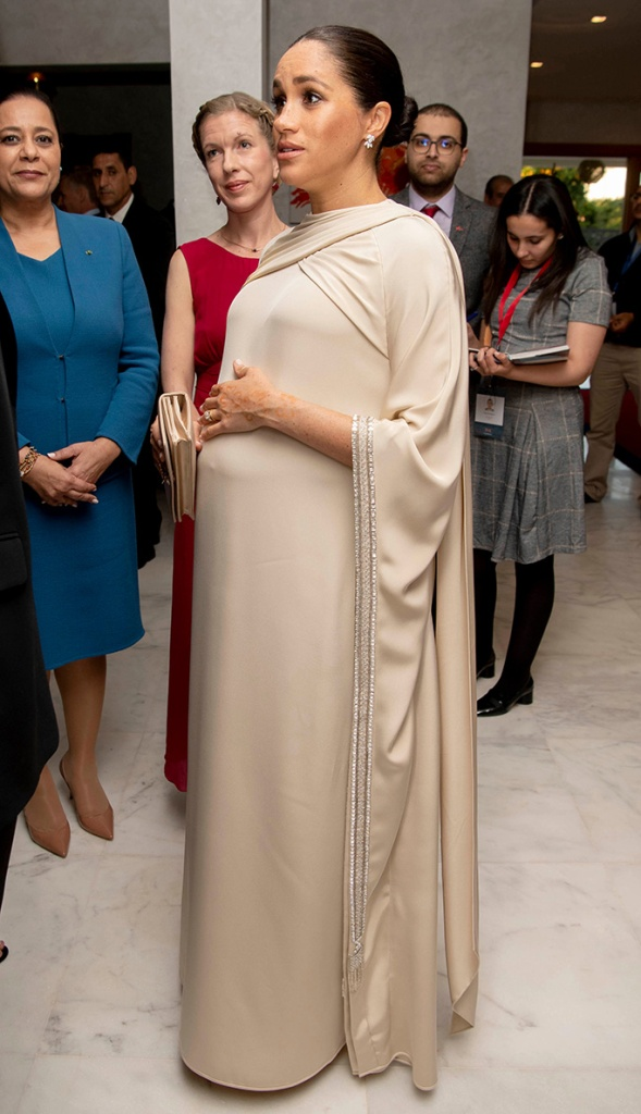 Meghan, dior, kaftan, gown, gold pumps, Duchess of Sussex attends a Reception hosted by Thomas Reilly the British Ambassador to Morocco at the British Residence, Rabat.Prince Harry and Meghan Duchess of Sussex visit to Morocco - 24 Feb 2019