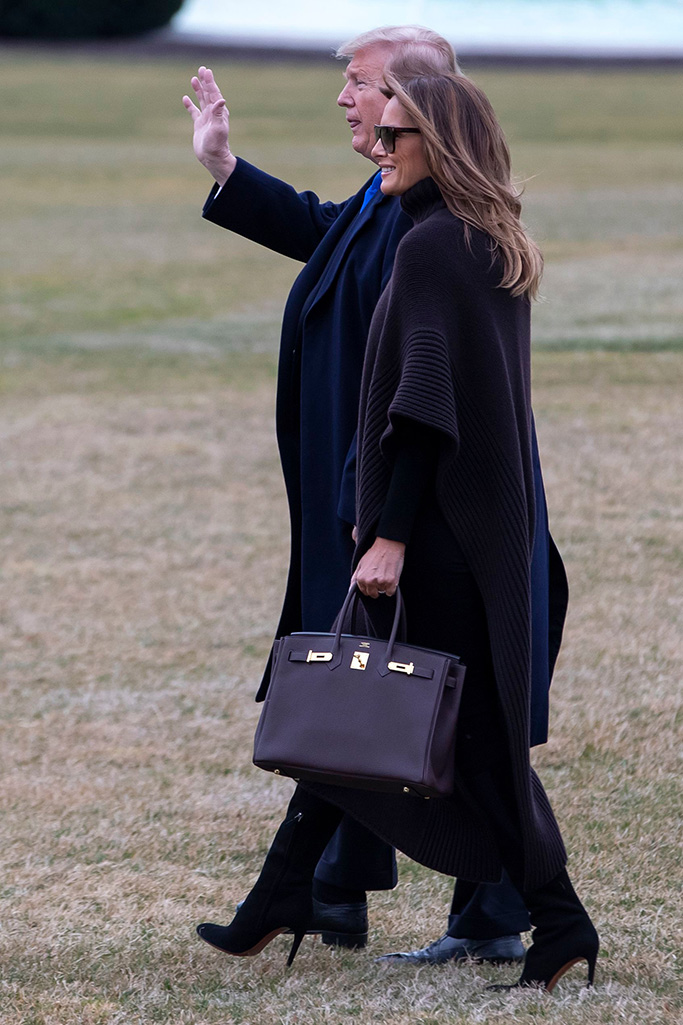 Donald Trump, Melania Trump. President Donald Trump and first lady Melania Trump walk to Marine One on the South Lawn of the White House in Washington, for the short trip to Andrews Air Force Base, Maryland. The Trumps are heading to their Mar-a-Lago estate in Florida for the long weekendTrump, Washington, USA - 15 Feb 2019, black sweater dress, black boots, hermes bag