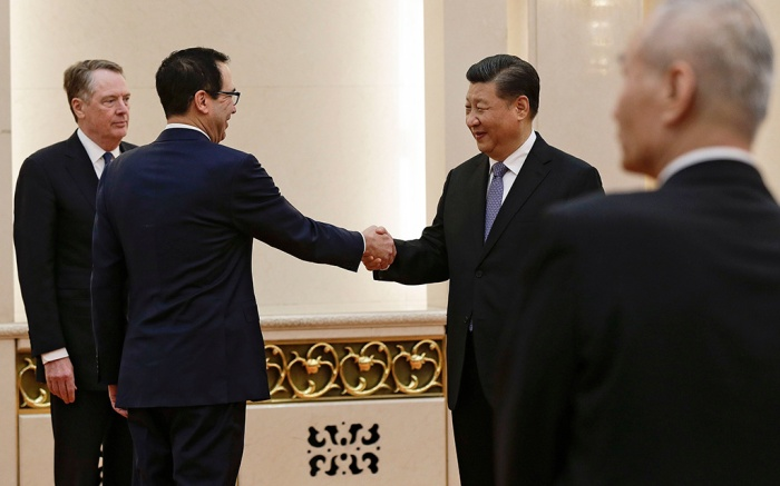 US Treasury Secretary Steven Mnuchin (2-L) shakes hands with Chinese President Xi Jinping (2-R) as US Trade Representative Robert Lighthizer (L) and Chinese Vice Premier Liu He (R) look on before proceeding to their meeting at the Great Hall of the People in Beijing, China, 15 February 2019. A US delegation headed by Secretary Mnuchin is in Beijing to conduct bilateral trade talks with China.Robert Lighthizer, Steven Mnuchin, Xi Jinping, Beijing, China - 15 Feb 2019