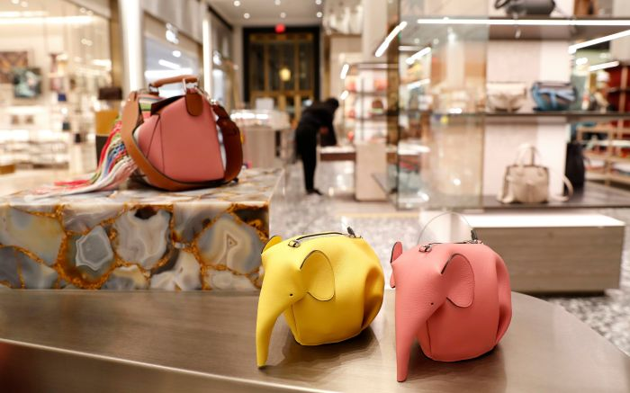 Elephant handbags displayed at Saks Fifth Avenue, part of an initiative to improve the in-store shopping experience.