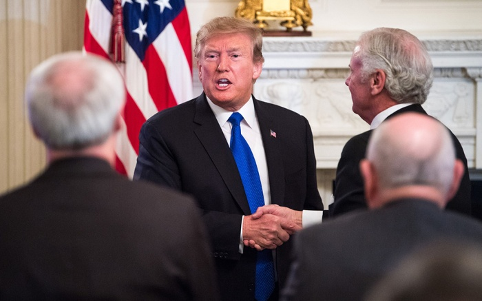 United States President Donald J. Trump shakes hands with governors after addressing the 2019 White House Business Session at the White House in Washington, D.C.. Trump discusses the group on infrastructure, the opioid epidemic, border security and China trade policy.President Trump addresses the nation's governors, Washington DC, USA - 25 Feb 2019