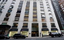 Pedestrians pass Barneys New York department
