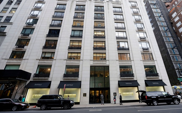 "Pedestrians pass Barneys New York department store in New York. Rap artist Jay-Z has said he's been unfairly ""demonized"" because he hasn't backed out of his collaboration with Barneys New York, accused of racially profiling two black customersBarneys Controversy, New York, USA"