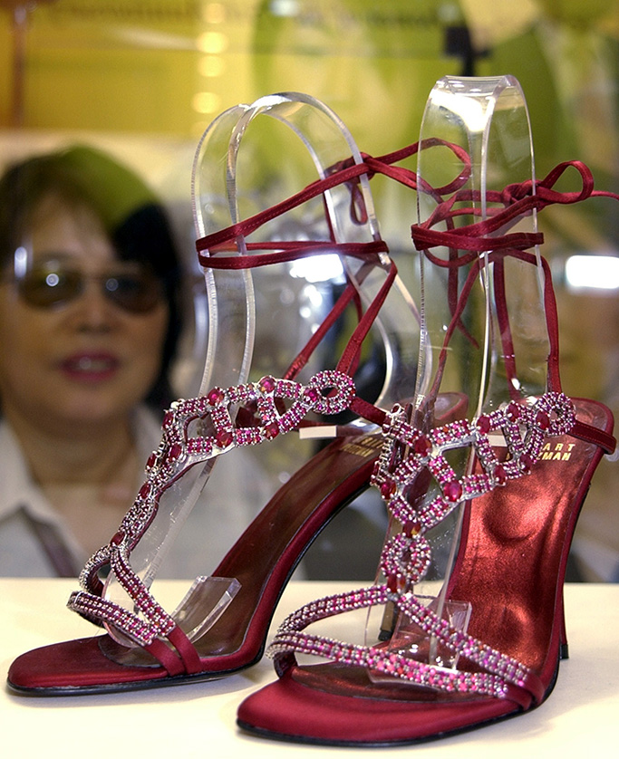 """RUBY SANDALS Shoppers at a Tokyo department store admire a pair of sandals worth 180 millionyen ($1.5 million) on display in Tokyo . Modeled after a pair of ruby slippers worn by Dorothy in""""Wizard of Oz,"""" the sandals are studded with 690 rubies and made for an actress to wear for the Oscar presentation by Stuart Weitzman and Oscar Heiman. The sandals were never worn as Oscar stars decided to dress-down for the ceremony because of the Iraq warJAPAN RUBY SANDALS, TOKYO, Japan"""