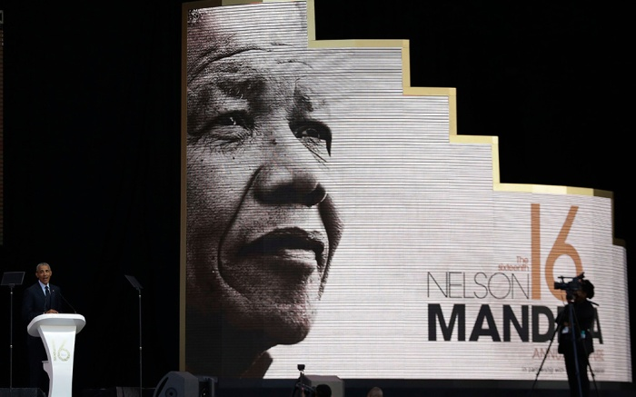Former U.S. President Barack Obama, left, delivers his speech at the 16th Annual Nelson Mandela Lecture at the Wanderers Stadium in Johannesburg, South Africa, . In his highest-profile speech since leaving office, Obama urged people around the world to respect human rights and other values under threat in an address marking the 100th anniversary of anti-apartheid leader Nelson Mandela's birthObama Mandela Speech, Johannesburg, South Africa - 17 Jul 2018