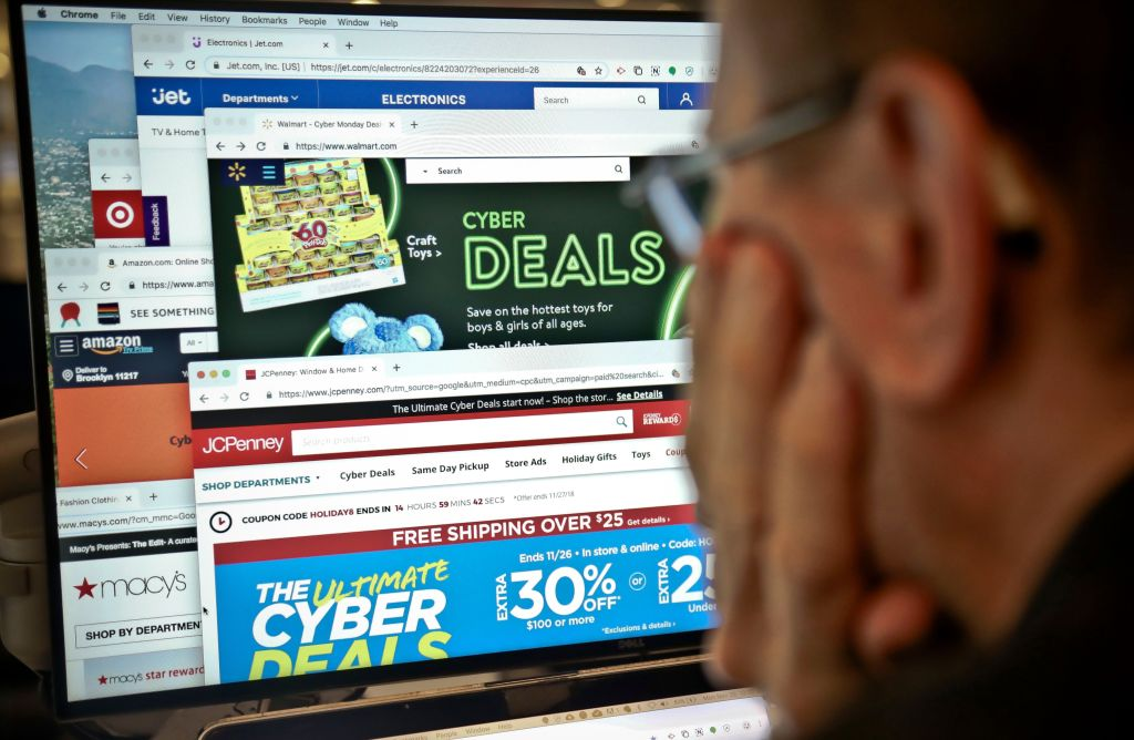 A journalist looks at a computer screen with webpages arranged to show Cyber Monday deals by various online retailers, in New York. The physical rush of Black Friday and the armchair browsing of Cyber Monday are increasingly blending into one big holiday shopping event as more customers buy items online and pick them up at brick-and-mortar storesHoliday Shopping, New York, USA - 26 Nov 2018