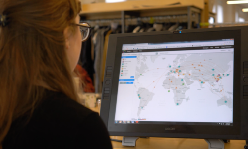 Sourcemap Screenshot of a woman looking at a supply chain map