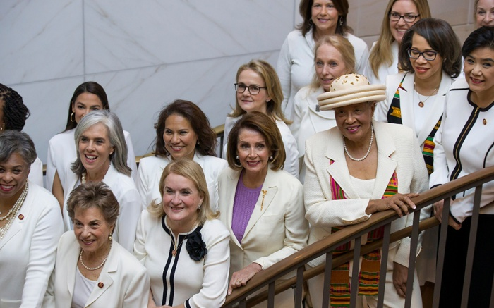 House Speaker Nancy Pelosi of Calif., center, is joined by other women wearing white, as they pose for a group photo before the State of the Union address by President Donald Trump, on Capitol Hill, in WashingtonState of Union, Washington, USA - 05 Feb 2019
