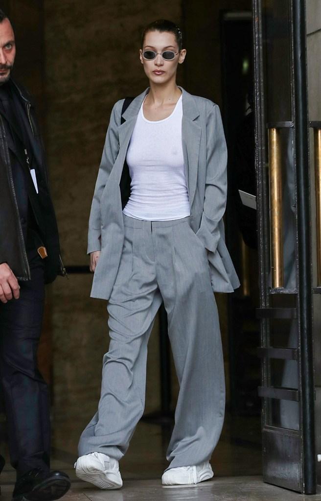 Bella Hadid, pantsuit, white sneakers, see-through shirt, no bra, paris fashion week, celebrity style, Bella Hadid out and about, Paris Fashion Week, France - 02 Mar 2019