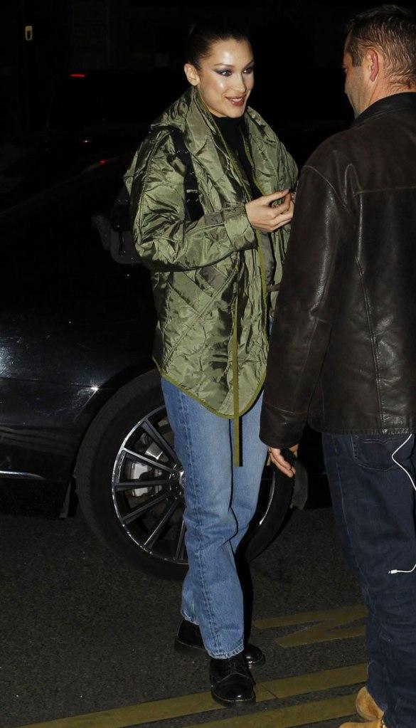 bella hadid, celebrity style, blue jeans, green coat, paris