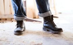 Legs of a woman worker.; Shutterstock