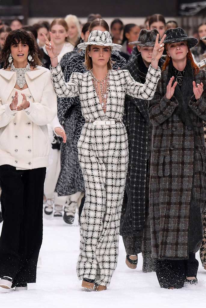 Chanel fall '19 finale with Cara Delevingne and friends bid an emotional farewell to Karl Lagerfeld at Chanel fall '19.