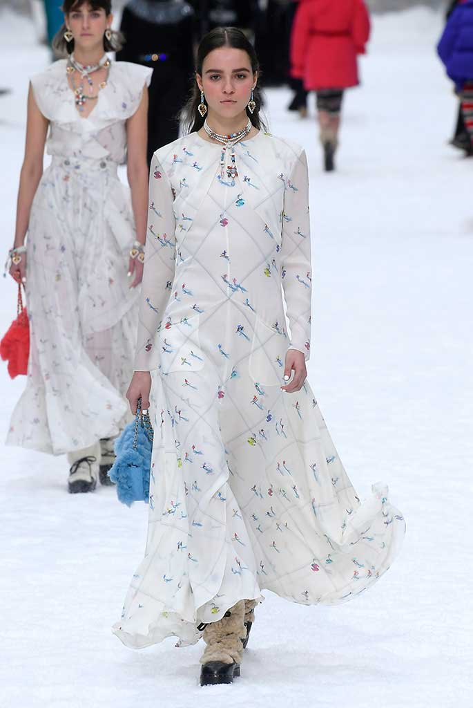 A dress printed with tiny renderings of Chanel skiers.