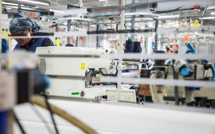 Minimum usage fee is £35Mandatory Credit: Photo by REX/Shutterstock (9156391a)MODEL RELEASED, Seamstress working in factory, Cape Town, South AfricaVARIOUS