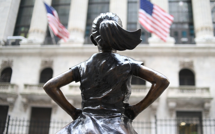 Statue of Fearless Girl is a woman in front of a stock exchange on International Women's Day.Fearless Girl statue, New York, USA - 08 Mar 2019