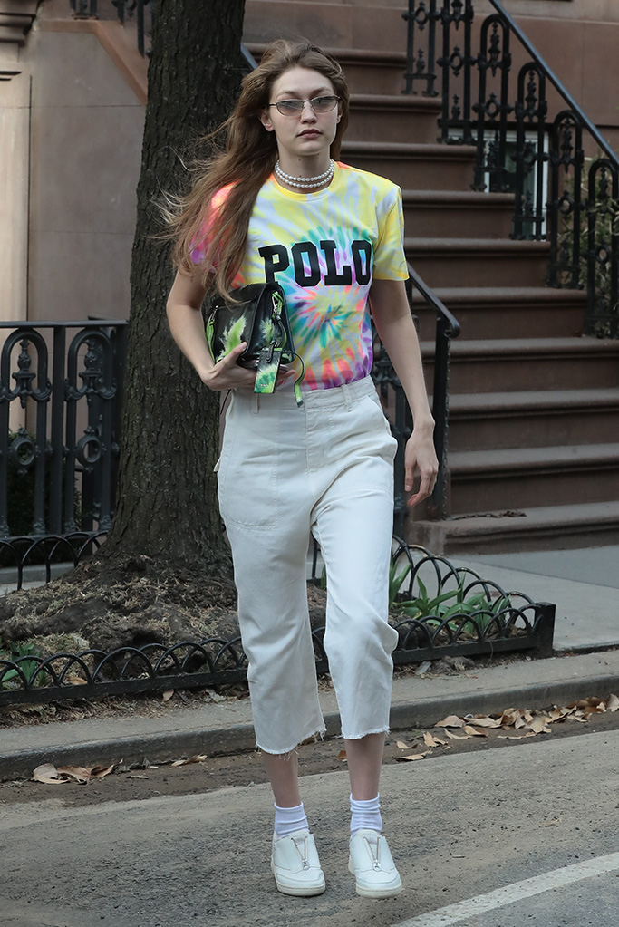 Gigi Hadid , reebok club c zip, ralph lauren polo, tie-dye, celebrity style, leaves apartment building in West Village New YorkPictured: Gigi HadidRef: SPL5075952 300319 NON-EXCLUSIVEPicture by: SplashNews.comSplash News and PicturesLos Angeles: 310-821-2666New York: 212-619-2666London: 0207 644 7656Milan: 02 4399 8577photodesk@splashnews.comWorld Rights