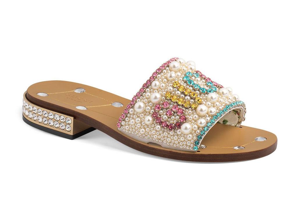 Jeweled leather Gucci slides.