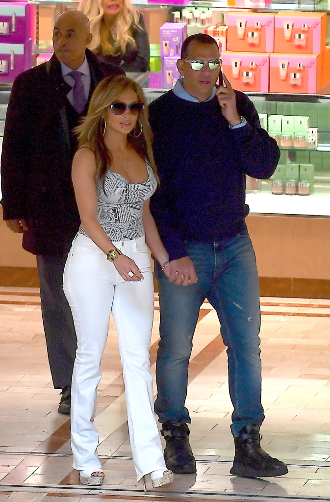 Jennifer Lopez and Alex Rodriguez, hustlers set, newspaper print tank top