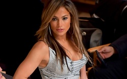 Jennifer Lopez, newspaper print tank top,