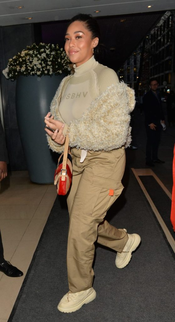 Jordyn Woods, cargo pants, sneaker boots, t-shirt, teddy coat, red purse, celebrity style, seen out and about in LondonPictured: Jordyn WoodsRef: SPL5075539 280319 NON-EXCLUSIVEPicture by: PALACE LEE / SplashNews.comSplash News and PicturesLos Angeles: 310-821-2666New York: 212-619-2666London: 0207 644 7656Milan: 02 4399 8577photodesk@splashnews.comWorld Rights