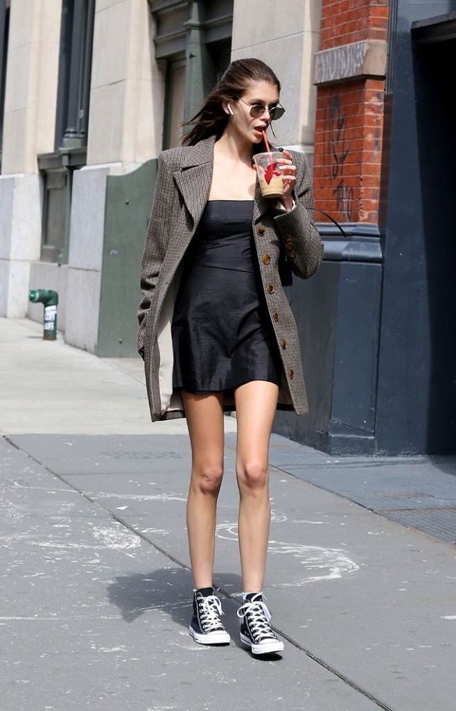 Kaia Gerber is seen looking fashionable while sipping a cold beverage on a nice Spring like day in Manhattan's Soho neighborhood. Kaia is also seen sporting bleached eyebrows. 30 Mar 2019 Pictured: Kaia Gerber. Photo credit: LRNYC / MEGA TheMegaAgency.com +1 888 505 6342 (Mega Agency TagID: MEGA390860_004.jpg) [Photo via Mega Agency]